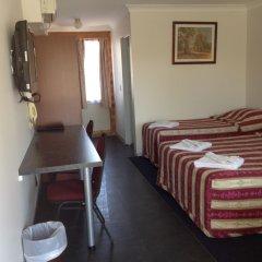 Отель Homestead Motel в номере