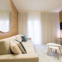 Отель Metropol Ceccarini Suite Риччоне комната для гостей фото 14