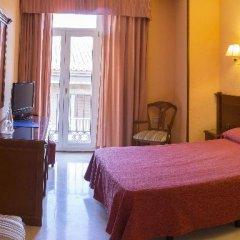 Отель Reina Cristina сейф в номере