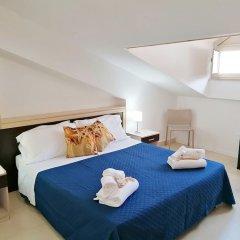 Апартаменты Il Cantone del Faro Apartments Таормина комната для гостей фото 4