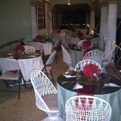 Отель Palm Bay Guest House & Restaurant Ямайка, Монтего-Бей - отзывы, цены и фото номеров - забронировать отель Palm Bay Guest House & Restaurant онлайн питание