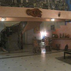 Отель Axari Hotel & Suites Нигерия, Калабар - отзывы, цены и фото номеров - забронировать отель Axari Hotel & Suites онлайн интерьер отеля фото 3