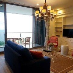 Отель Baan Plai Haad Beachfront Condominium Паттайя комната для гостей