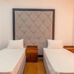 Отель Metro Port City Hotel Шри-Ланка, Коломбо - отзывы, цены и фото номеров - забронировать отель Metro Port City Hotel онлайн комната для гостей фото 4