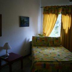 Отель San San Tropez Ямайка, Порт Антонио - отзывы, цены и фото номеров - забронировать отель San San Tropez онлайн комната для гостей