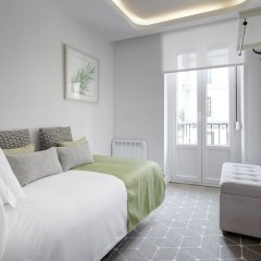 Апартаменты San Juan Apartment by FeelFree Rentals комната для гостей