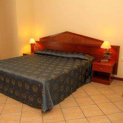 Отель Assinos Palace Джардини Наксос сейф в номере