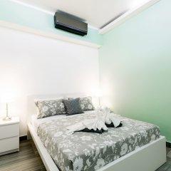 Отель Ducassi Suites Rooftop Pool Beach Club & Spa сейф в номере
