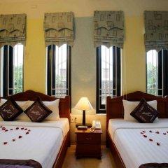 Отель Magnolia Garden Villa сейф в номере