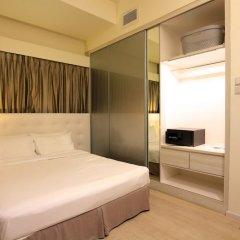 Апартаменты Orange Grove Service Apartment by ST Residences сейф в номере