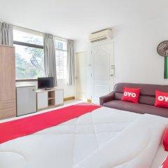 Апартаменты OYO 648 Ake Apartment Паттайя комната для гостей фото 2