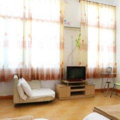 Апартаменты Xingyuan Apartment Сямынь комната для гостей фото 5