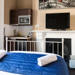 Oyo Belgravia Hotel удобства в номере