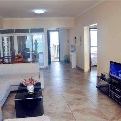 Апартаменты Sanya Haizhixing Seascape Holiday Apartment комната для гостей фото 5