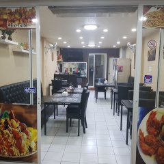 Отель Royal Inn Kitchen and Bar