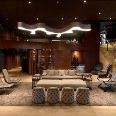 Отель Pan Pacific Serviced Suites Beach Road, Singapore интерьер отеля фото 3
