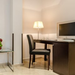 Hotel Exe Suites 33 удобства в номере