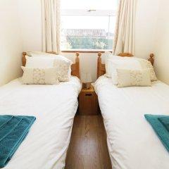 Отель The Bungalow комната для гостей