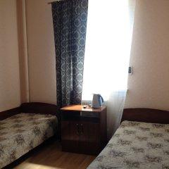 Гостиница Альфа комната для гостей фото 4
