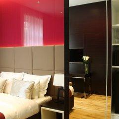 Отель Maccani Luxury Suites сейф в номере