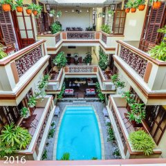 Отель Nhi Nhi Хойан бассейн
