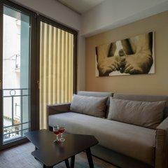 Отель Fos DownTown Suites Афины комната для гостей фото 17