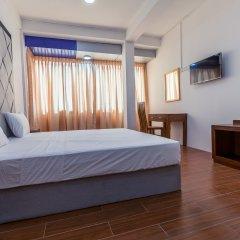 Отель Metro Port City Hotel Шри-Ланка, Коломбо - отзывы, цены и фото номеров - забронировать отель Metro Port City Hotel онлайн комната для гостей фото 2