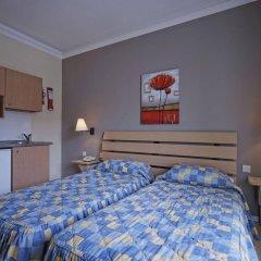 Отель Porto Azzurro Aparthotel комната для гостей фото 2