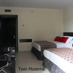 Porton Medellin Hotel сейф в номере
