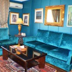 Gondola Hotel & Suites Амман комната для гостей