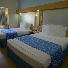 Отель Microtel Inn And Suites Davao Филиппины, Давао - отзывы, цены и фото номеров - забронировать отель Microtel Inn And Suites Davao онлайн комната для гостей фото 4