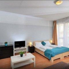 Апартаменты Agape Apartments комната для гостей фото 3