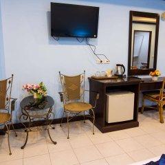 Отель The Grand Orchid Inn удобства в номере