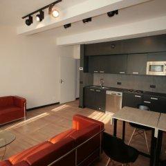 Апартаменты Amosa Apartments Rue Donceel 6 комната для гостей