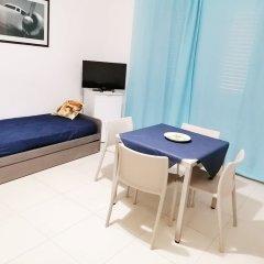 Апартаменты Il Cantone del Faro Apartments Таормина комната для гостей