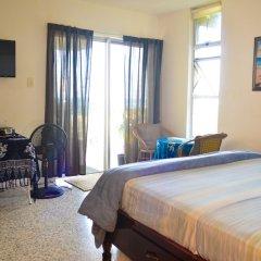 Отель Crystal Beach Studio Ямайка, Монтего-Бей - отзывы, цены и фото номеров - забронировать отель Crystal Beach Studio онлайн комната для гостей фото 5
