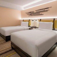 Отель DoubleTree by Hilton Bangkok Ploenchit Бангкок комната для гостей фото 16