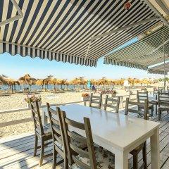 Отель Festa Pomorie Resort Болгария, Поморие - 1 отзыв об отеле, цены и фото номеров - забронировать отель Festa Pomorie Resort онлайн пляж фото 2
