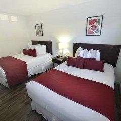 Отель Regency Inn & Suites комната для гостей фото 3