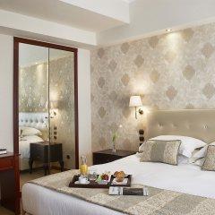 AVA Hotel & Suites в номере