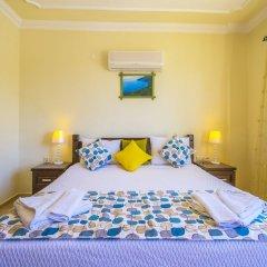 Villa Asel by Akdenizvillam Турция, Калкан - отзывы, цены и фото номеров - забронировать отель Villa Asel by Akdenizvillam онлайн комната для гостей фото 3