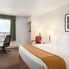 Отель Travelodge by Wyndham Calgary International Airport South Канада, Калгари - отзывы, цены и фото номеров - забронировать отель Travelodge by Wyndham Calgary International Airport South онлайн комната для гостей