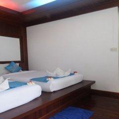 Отель Lanta Sunny House Ланта сейф в номере
