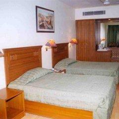 Отель Grand Sartaj Hotel Индия, Нью-Дели - отзывы, цены и фото номеров - забронировать отель Grand Sartaj Hotel онлайн комната для гостей фото 2