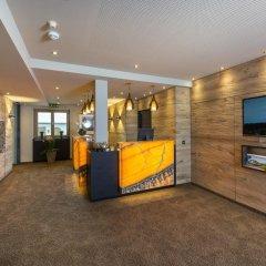 Отель Aparthotel Bergland Австрия, Зёлль - отзывы, цены и фото номеров - забронировать отель Aparthotel Bergland онлайн интерьер отеля