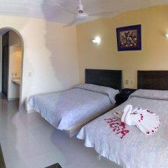 Hotel Zihuatanejo Centro комната для гостей фото 3