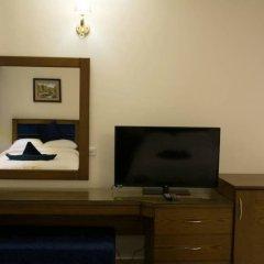 Отель Seashore Homes удобства в номере