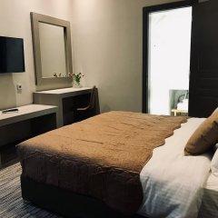 Отель Metis Athens Suites Афины комната для гостей фото 2