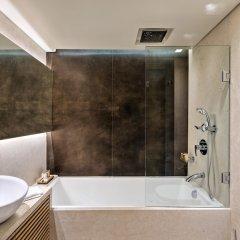 Отель Rodos Park Suites & Spa Греция, Родос - 1 отзыв об отеле, цены и фото номеров - забронировать отель Rodos Park Suites & Spa онлайн ванная