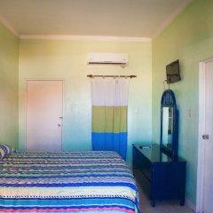 Отель Caribic House Hotel Ямайка, Монтего-Бей - отзывы, цены и фото номеров - забронировать отель Caribic House Hotel онлайн комната для гостей